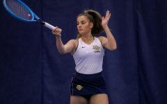 Elizabeth Ferdman hits a forehand in November 2019. (Photo courtesy of Marquette Athletics.)