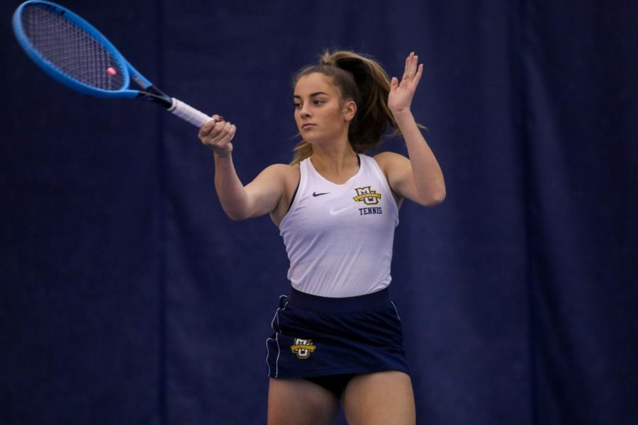 Elizabeth+Ferdman+hits+a+forehand+in+November+2019.+%28Photo+courtesy+of+Marquette+Athletics.%29