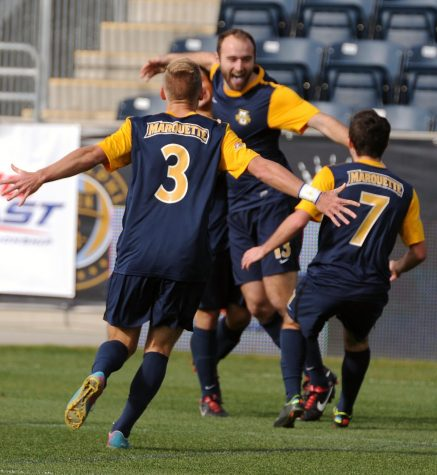 Dennis Holowaty (3) and Kelmend Islami (7) run to join Nick Parianos (13) in celebration after the Golden Eagles defeated Providence in the BIG EAST Tournament final in 2013. (Photo courtesy of Marquette Athletics.)
