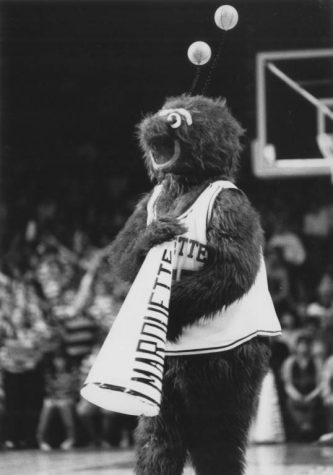 Bleuteaux cheers at a Marquette basketball game, circa 1985. Photo courtesy Department of Special Collections and University Archives, Raynor Memorial Libraries, Marquette University.