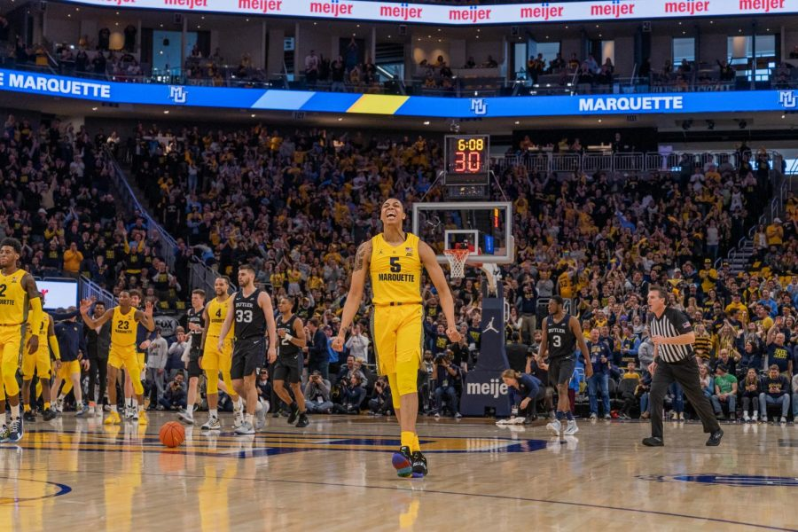 Greg Elliott (5) celebrates during the Golden Eagles' National Marquette Day game against Butler at Fiserv Forum Feb. 9, 2020.