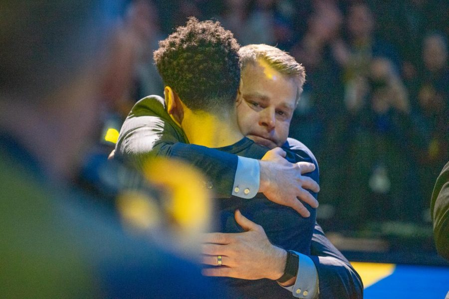 Head coach Steve Wojciechowski hugs guard Markus Howard prior to Marquette's game against Seton Hall on Senior Day last season.