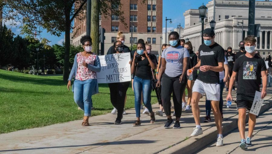 Marquette students walked alongside student-athletes to combat social injustices Sept. 4.
