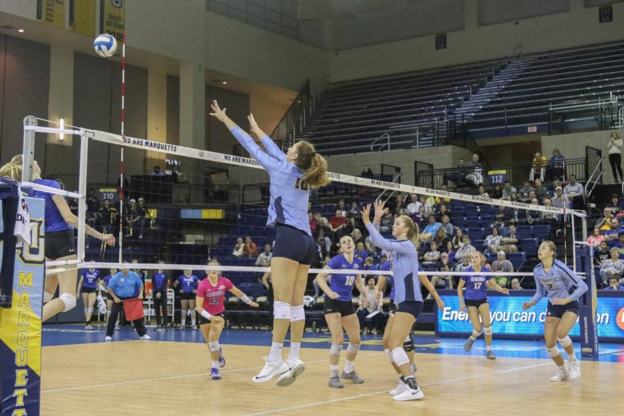Allie Barber (10) attempts a block in Marquettes sweep over Seton Hall Sept. 27, 2019. Barber is the all-time leader in kills in program history.