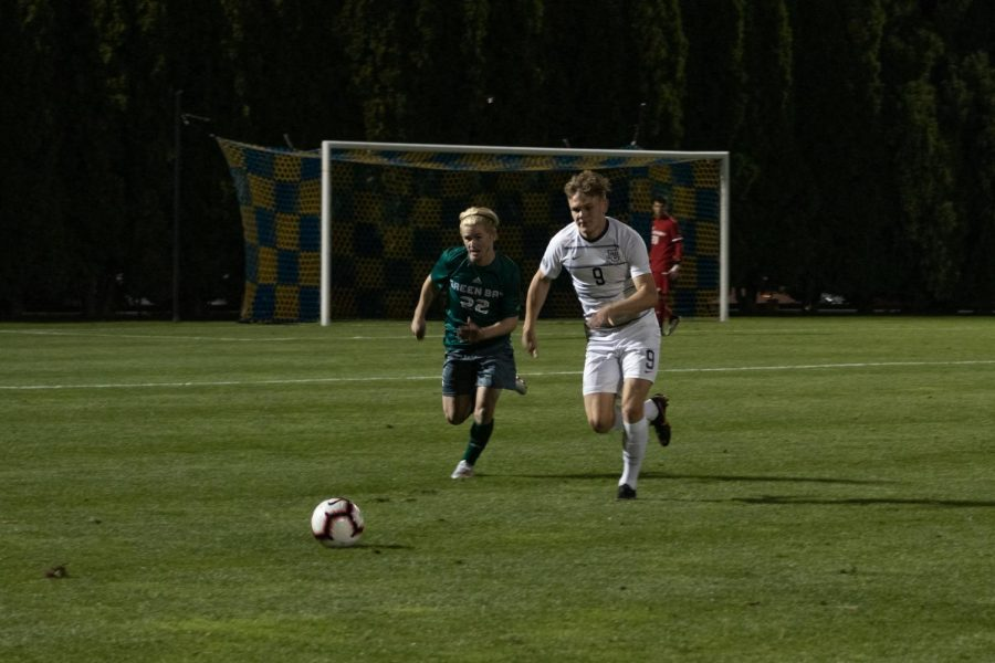 Junior forward Lukas Sunesson races to the ball in a match last season against Green Bay.