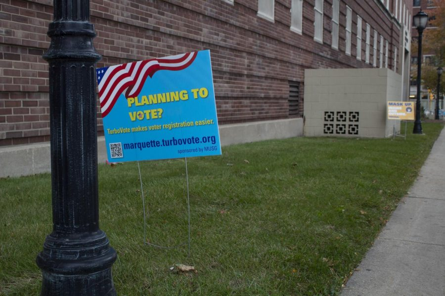 Signs around campus encourage Marquette students to vote.