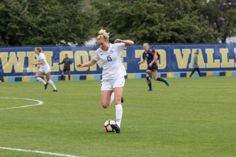 Alyssa Bombacino (15) in a match against Utah State last season. Bombacino would go on to become the first player in program history to have back-to-back hat tricks.