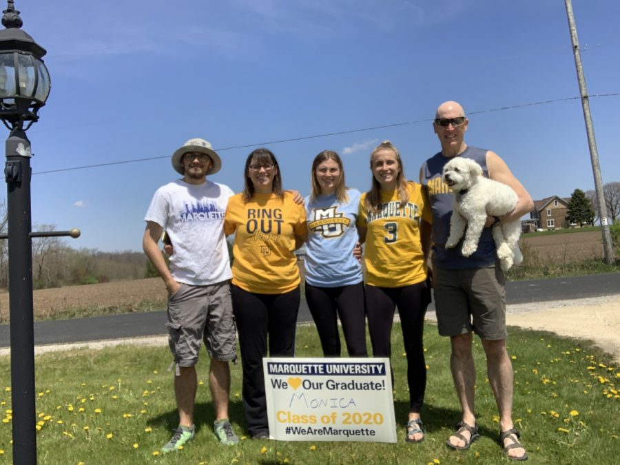 Class of 2020 graduate Monica Geiser wears Marquette attire alongside her family, which includes her parents, who are Marquette alumni, and her sister Gretchen, a current Marquette student. Photo courtesy Monica Geiser.