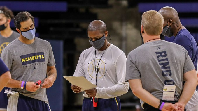 Marquette men's basketball coaches Jake Presutti, Justin Gainey, Steve Wojciechowski and Dwayne Killings (left to right) talk during practice. (Photo courtesy of Marquette Athletics.)