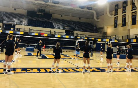 The volleyball team huddles during practice Oct. 15. (Photo courtesy of Marquette Athletics.)