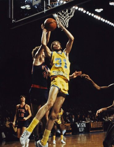 Bo Ellis jumps for a rebound during a game against DePaul circa 1976-77. Photo courtesy the Department of Special Collections and University Archives, Raynor Memorial Libraries, Marquette University.