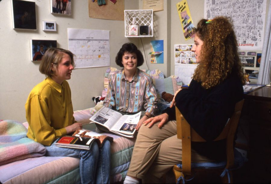 Three students hang out in Cobeen Hall in 1984. Photo courtesy Department of Special Collections and University Archives, Raynor Memorial Libraries, Marquette University.
