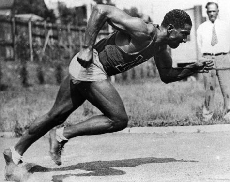 Ralph Metcalfe sprints while coach Conrad Jennings looks on, circa 1932-36. Photo courtesy Department of Special Collections and University Archives, Raynor Memorial Libraries, Marquette University.