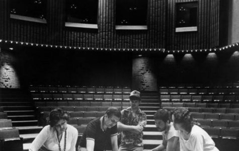 Marquette Theatre Arts students, alongside a professor, look over drawings for an upcoming performance in the Helfaer Theatre. Photo courtesy Department of Special Collections and University Archives, Raynor Memorial Libraries, Marquette University.
