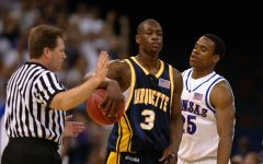 Dwyane Wade plays on the court in the April 5, 2003 game against  Kansas in the NCAA Final Four. Photo courtesy the Department of Special Collections and University Archives, Marquette University Libraries