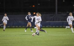 Rachel Johnson (23) dribbles the ball in Marquette's Senior Night game against Xavier Oct. 24, 2019. (Photo courtesy of Marquette Athletics.)