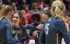 Sarah Rose (4) with teammates during matchup at UW-Madison last season.