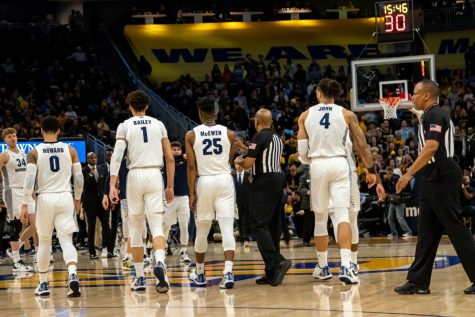Markus Howard (0), Brendan Bailey (1), Koby McEwen (25) and Theo John (4) head to the bench during a game against Georgetown last season.