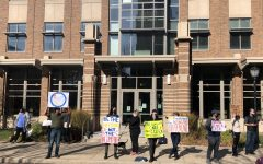 Protesters stand outside of Zilber while McArdle's hearing happens at the same time.
