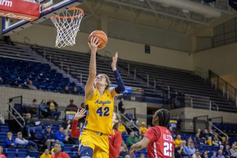 Lauren Van Kleunen (42) goes up for the layup in Marquette