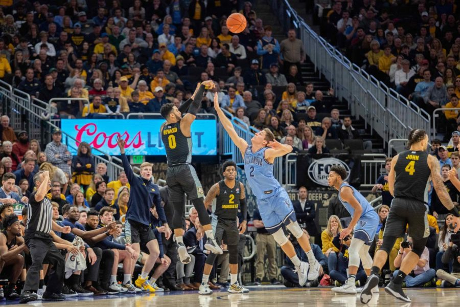 Markus Howard (0) shoots 3-pointer in Marquette's 71-60 upset over then-No. 10 Villanova Feb. 4.