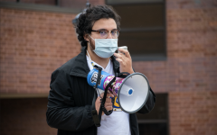 Senior Alex Liberato held a protest to change the university seal Oct. 12.