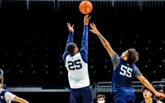 Koby McEwen (25) shoots a shot over Jose Perez (55) at practice at Fiserv Forum Nov. 7. (Photo courtesy of Marquette Athletics.)