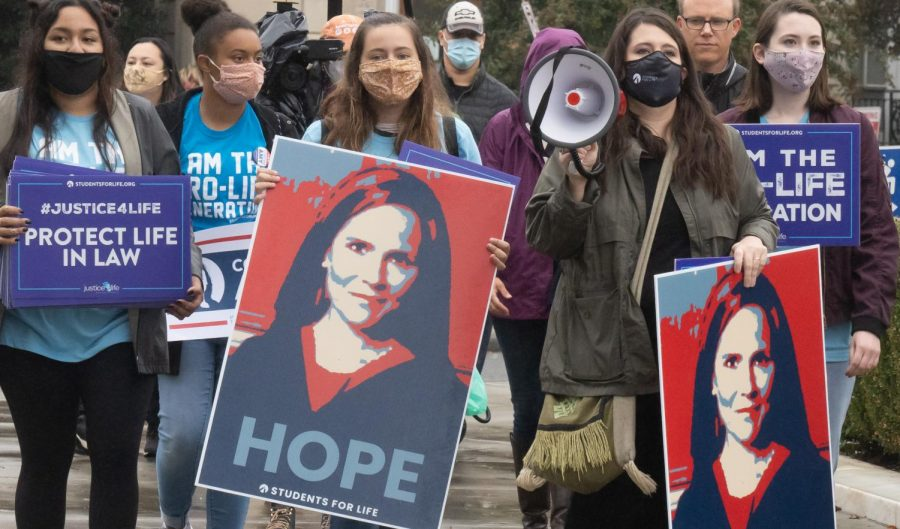 Supporters stand outside the Supreme Court during the judiciary hearing for Amy Coney Barrett's nomination Oct. 12. Photo via Flickr