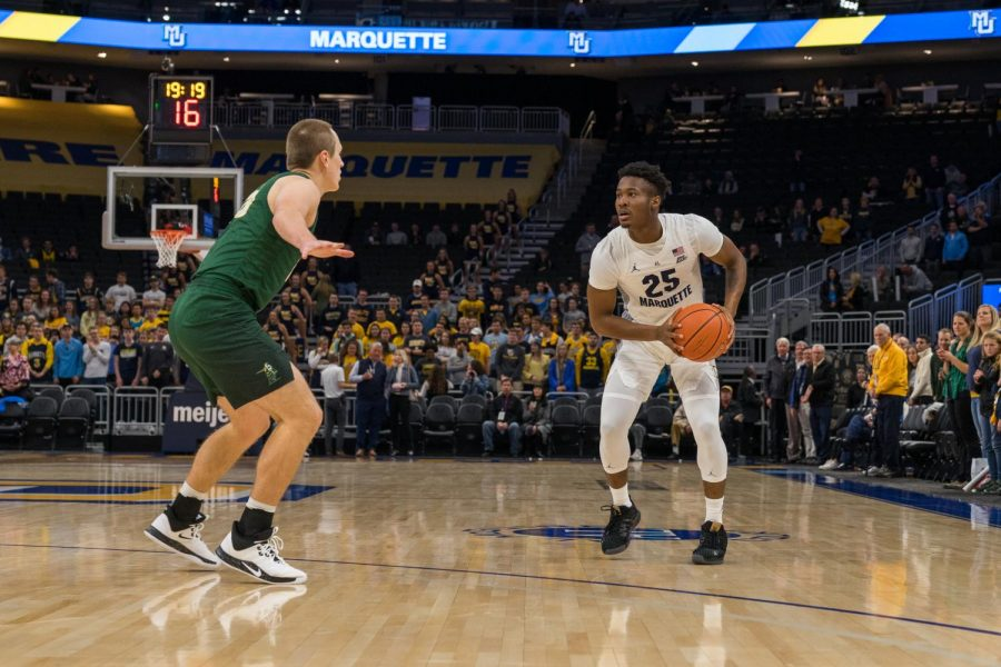 Redshirt senior guard Koby McEwen (25) looks to make a move in a game against St. Norbert's College last season. Kameron Jones and Stevie Mitchell will look to take over in the backcourt next season following McEwen's possible departure.