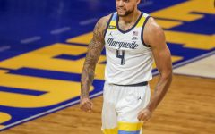 Theo John recorded a double-double for the Golden Eagles, posting 13 points and 12 rebounds (Photo courtesy of Marquette Athletics.)