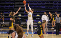 Lauren Van Kleunen (42) attempts a jumper in Marquette's 64-55 loss to University of Wisconsin-Milwaukee on Dec. 2. (Photo courtesy of Marquette Athletics)
