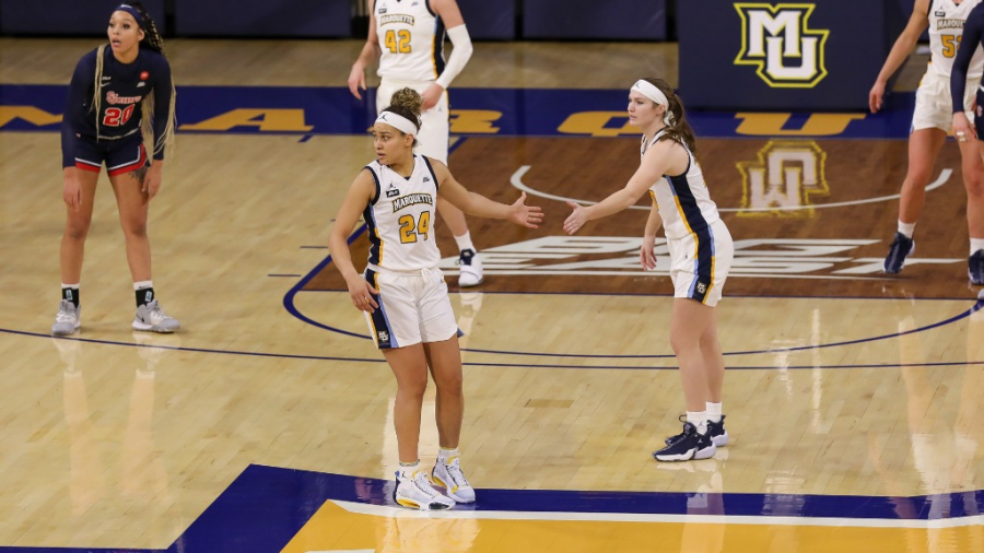 Selena Lott (left) and Claire Kaifes (right) exchange a high-five during Marquette's 66-62 win over St. John's on Dec. 16 2020. (Photo Courtesy of Marquette Athletics. )