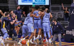 The Marquette men's basketball team celebrates after first-year forward Justin Lewis tipped in the game-winning shot at the buzzer against Wisconsin (Photo courtesy of Marquette Athletics.)
