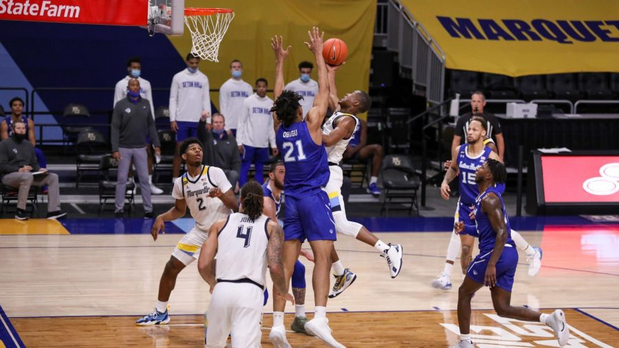 Koby McEwen puts up a shot in Marquette's 70-63 loss to Seton Hall Thursday night. (Photo courtesy of Marquette Athletics.)