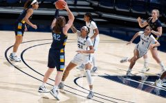 Lauren Van Kleunen (42) looks for a teammate to pass to in Marquette's win at Xavier Tuesday. (Photo courtesy of Marquette Athletics.)