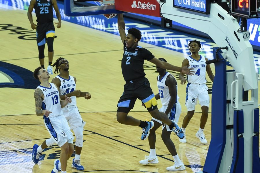 First-year forward Justin Lewis (2) throws home a dunk in front of Creighton defenders (Photo courtesy of Marquette Athletics.)