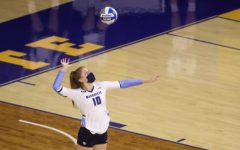 Senior Taylor Wolf serves the ball against ISU (Photo courtesy of Marquette Athletics.)