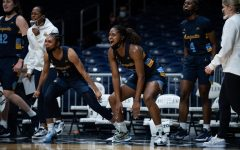 Taylor Valladay (left), Camryn Taylor (center) and Antwainette Walker (right) cheers on from the bench in Marquette's 95-56 win over Butler on Jan. 24 2020. (Photo Courtesy of Butler Athletics.)