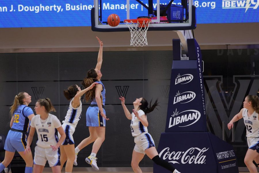 Chloe Marotta (52) attempts a layup in Marquette's win at Villanova. (Photo courtesy of Marquette Athletics.)
