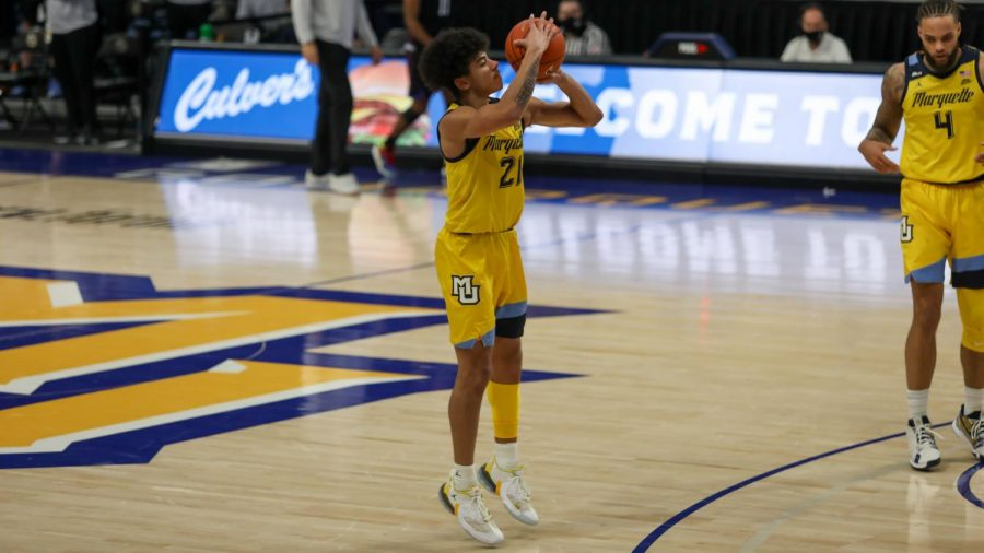 Sophomore guard D.J. Carton (21) shoots a three in Marquette's loss against DePaul on Jan. 23 (Photo courtesy of Marquette Athletics)
