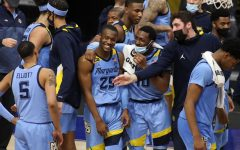 Redshirt senior guard Koby McEwen (25) celebrates with teammates after Marquette defeated Providence on Jan. 12 (Photo courtesy of Marquette Athletics.)