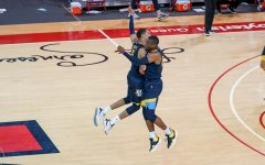 Redshirt junior guard Greg Elliott (5) and redshirt senior guard Koby McEwen (25) celebrate at Carnesecca Arena on Jan. 16 (Photo courtesy of Marquette Athletics.)