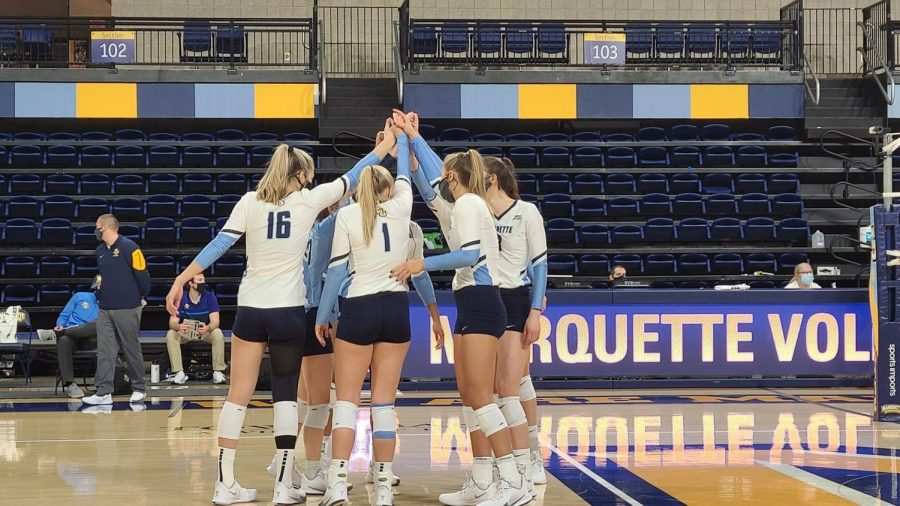 Marquette volleyball huddles prior to the team's sweep over Illinois State University Jan. 22. (Photo courtesy of Marquette Athletics.)