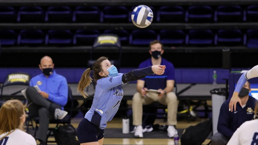Katie Schoessow (17) sets the ball. (Photo courtesy of Marquette Athletics.)
