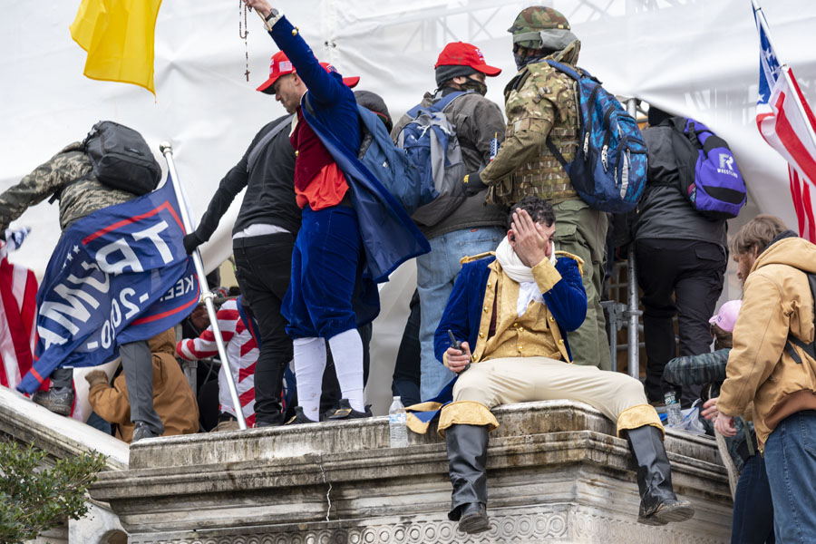 Rioters stand outside U.S. Capitol building as it is breached Jan. 6. Photo via Flickr