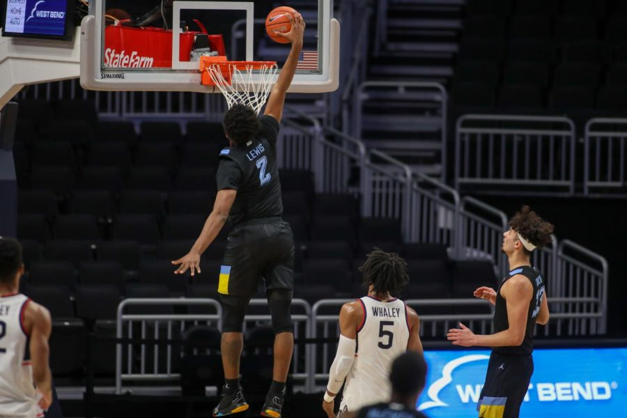 First-year forward Justin Lewis (2) goes up for a dunk against the UConn Huskies (Photo courtesy of Marquette Athletics.)