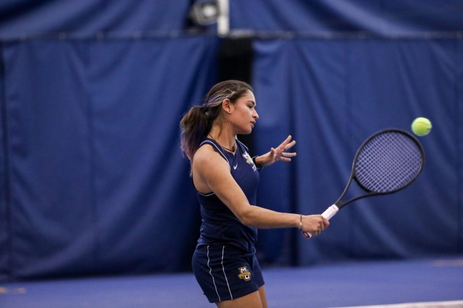 Tiana Windbuchler attempts a backhand volley Feb. 2. (Photo courtesy of Marquette Athletics.)