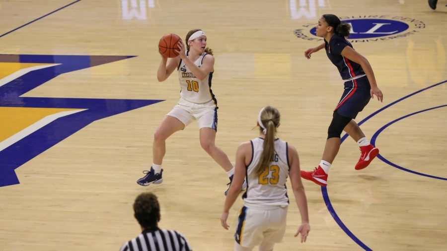 Claire Kaifes (10) looks to pass to a teammate in Marquette's win at Belmont Dec. 16, 2020. (Photo courtesy of Marquette Athletics.)