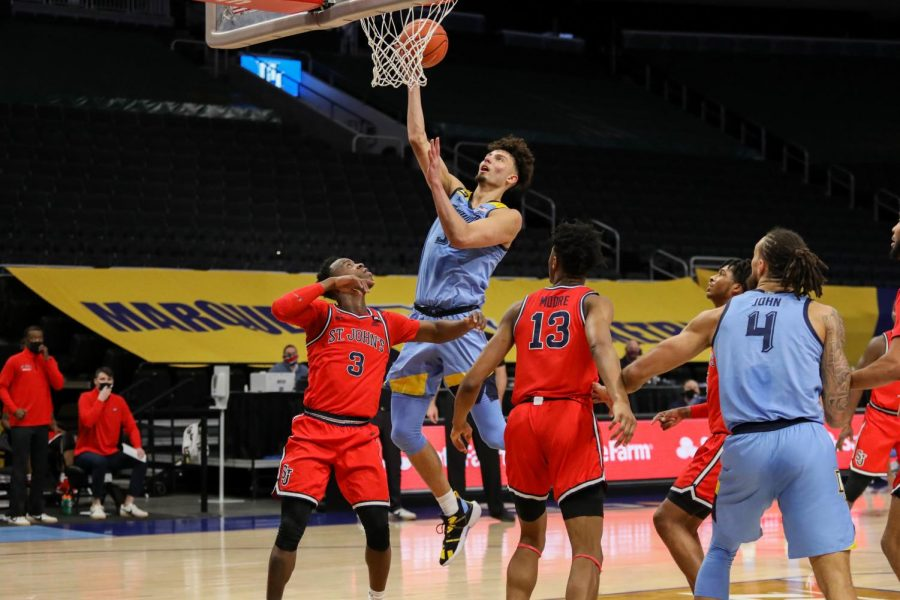 Dawson Garcia puts in. a layup over St. John's Jan. 31. (Photo courtesy of Marquette Athletics.)