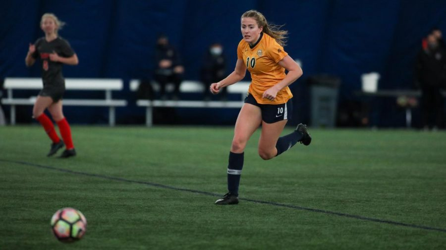 Elsi Twombly runs after the ball in Marquette women's soccer's game Feb. 7. (Photo courtesy of Marquette Athletics.)